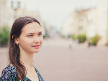 Close up of smiling young woman looking away Royalty Free Stock Photography