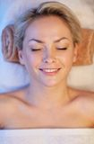 Close up of smiling young woman lying in spa Royalty Free Stock Photography