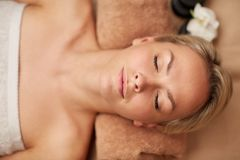 Close up of smiling young woman lying in spa Stock Photo