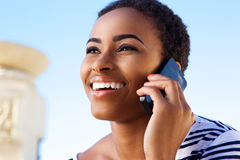 Close up smiling young woman talking on mobile phone Royalty Free Stock Images