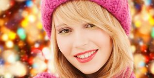 Close up of smiling young woman in winter clothes. Happiness, winter holidays, christmas and people concept - smiling close up of young woman in pink hat and stock photo