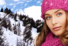 Close up of smiling young woman in winter clothes Stock Image