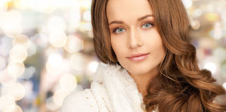 Close up of smiling young woman in winter clothes Stock Images
