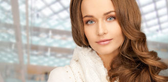Close up of smiling young woman in winter clothes Royalty Free Stock Images