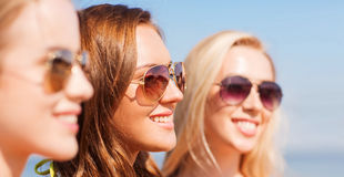Close up of smiling young women in sunglasses Royalty Free Stock Photography