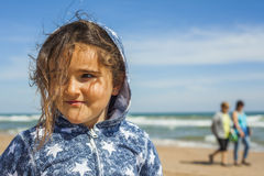 Close up smily girl posing in the beach in a windy day in Easter Stock Image