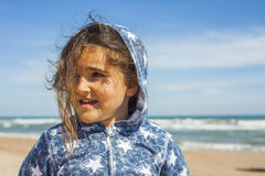 Close up smily girl posing in the beach in a windy day in Easter Stock Photo