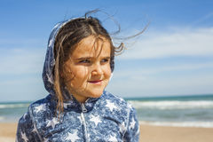 Close up smily girl posing in the beach in a windy day in Easter Royalty Free Stock Photos