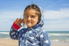 Close up smily girl posing in the beach in a windy day in Easter Royalty Free Stock Images