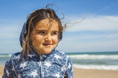 Close up smily girl posing in the beach in a windy day in Easter Stock Images