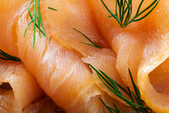 Close up of smoked salmon with dill garnish, food background Stock Image