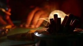 Smoking cigarette in workshop stock footage
