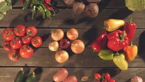 Top view of a table with a variety of vegetables. Close up. The smooth glide of the camera  from right to left  along the old village table with a variety of stock footage