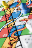 Close -Up Of Snakes And Ladders Board.  stock images