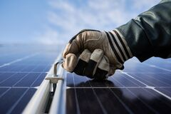 Free Close-up Snapshot Of A Man&x27;s Hand Wearing A Working Glove, Holding A Hex Key, Installing Solar Module Royalty Free Stock Photos - 212040488