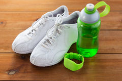 Close up of sneakers, bracelet and water bottle Stock Images