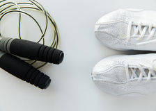 Close up of sneakers and skipping rope Royalty Free Stock Photos