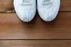 Close up of sneakers on wooden floor Stock Image