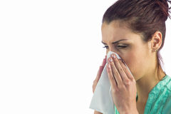 Close-up of sneezing woman with tissue on mouth Royalty Free Stock Photo