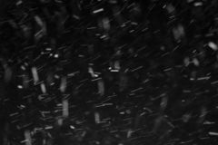 Windy snow at night. Close-up of snow against black night sky stock images