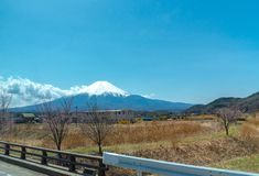 Close up snow covered Mount Fuji ( Mt. Fuji ) the World Heritage. In blue sky background on spring season sunny day. Fuji Five Lake region, Minamitsuru royalty free stock photography