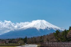 Close up snow covered Mount Fuji ( Mt. Fuji ) the World Heritage. In blue sky background on spring season sunny day. Fuji Five Lake region, Minamitsuru royalty free stock image