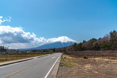 Close up snow covered Mount Fuji ( Mt. Fuji ) the World Heritage. In blue sky background on spring season sunny day. Fuji Five Lake region, Minamitsuru royalty free stock images