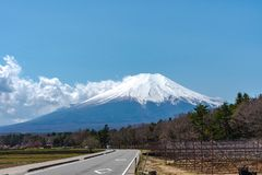 Close up snow covered Mount Fuji ( Mt. Fuji ) the World Heritage. In blue sky background on spring season sunny day. Fuji Five Lake region, Minamitsuru stock photo