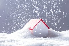 Snow Falling On House With Red Roof. Close-up Of Snow Falling On House With Red Roof In Winter royalty free stock photography