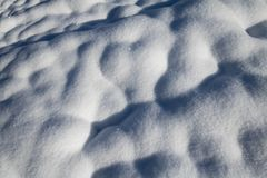 Close up on fluffy snowy ground surface texture. Close up of snow ground surface texture royalty free stock photo