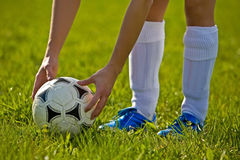 Close up of a soccer ball. With hands and feet Stock Photo