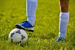 Close up of a soccer ball. And feet of a soccer player 3 Stock Images