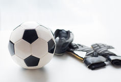 Close up of soccer ball, boots and gloves on table Royalty Free Stock Image