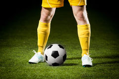 Soccer ball and a feet of a soccer player Stock Images