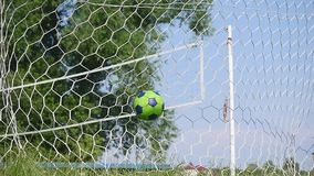 Close up of a soccer ball hitting a net stock video