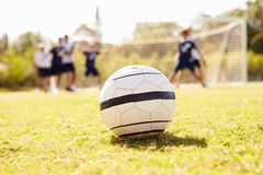 Close Up Of Soccer Ball With Players In Background Royalty Free Stock Photo