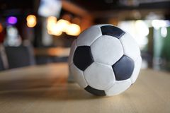 Close-up of a soccer ball on a wooden table royalty free stock photos