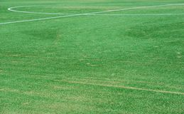 Close up on soccer field with artificial grass and white stripes stock photos