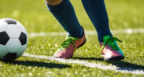 Close up soccer football kick the ball. Feet of footballer running and kicking soccer ball. Close up soccer football kick the ball. Feet of footballer running royalty free stock photos