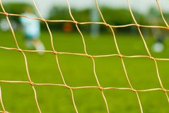 Close up of soccer net. Close view up of soccer net with field in background stock image
