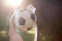 Close up of soccer player with ball on field Stock Photo