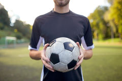 Close up of soccer player with football on field Stock Image