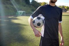 Close up of soccer player with football on field Royalty Free Stock Images