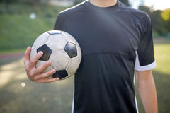 Close up of soccer player with football on field Stock Photo