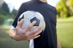 Close up of soccer player with football on field Royalty Free Stock Photography