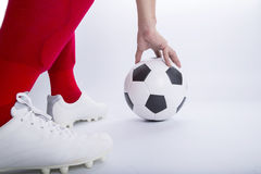 Close up soccer player use hand touch Stock Image