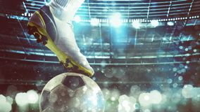 Close up of a soccer striker ready to kicks the ball at the stadium. Football scene at night match with player ready to shoot the ball stock images