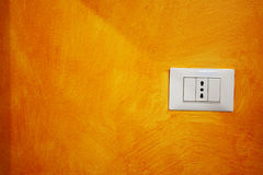 Close up of a socket in an orange wall Stock Photo