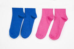 Close-up of socks hanging over white background Royalty Free Stock Image