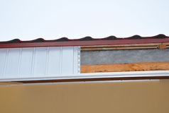 Close up on  Soffit and Fascia Installation. New House Roofing Construction. Royalty Free Stock Images